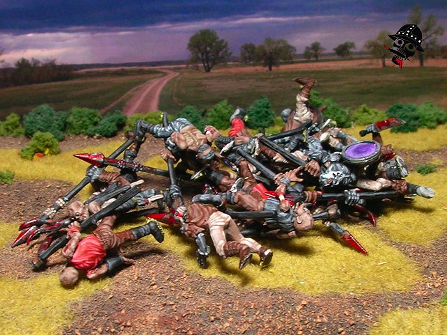 A regiments worth of painted zombies in a pile - figs from Games Workshop
